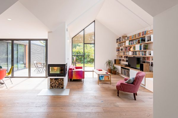 red furniture and a book shelf in a big fireplace