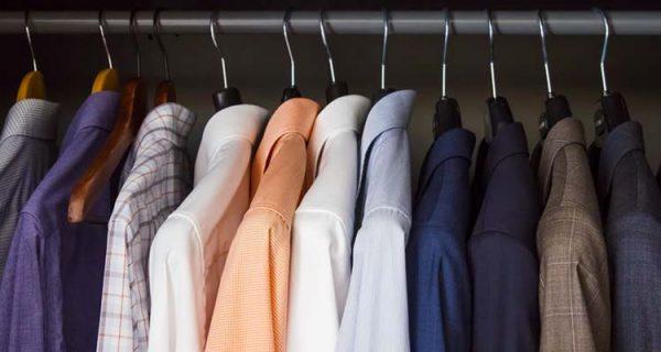formal men's attired in a cabinet rack