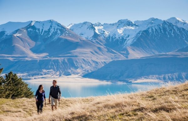 a couple hiking in the mountains of south new zealand