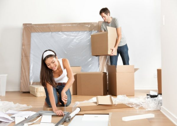 a young couple packing up for a home renovation