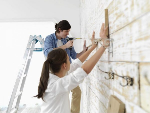 a young couple doing diy home renovation