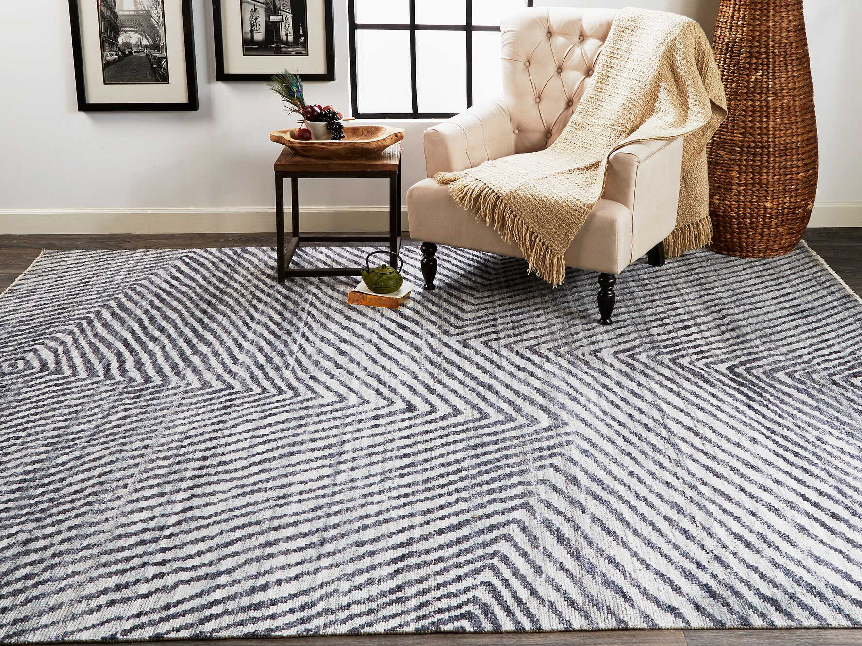 a classy chair on a rug with zigzag pattern