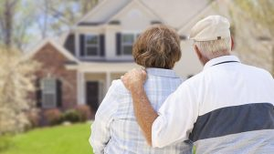Older couple looking at house