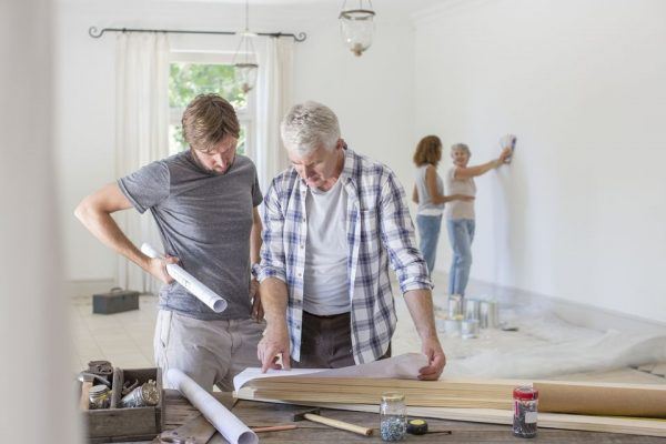 a family working together to renovate their home