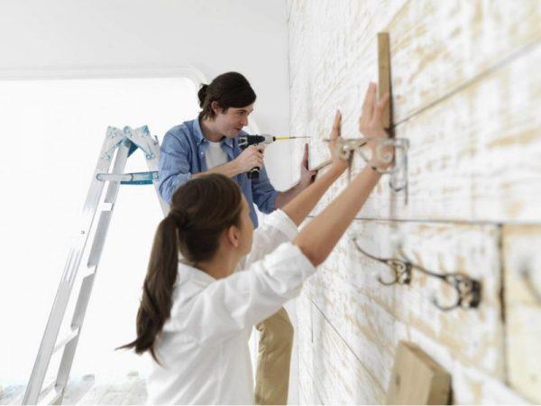 a young couple doing diy home renovation