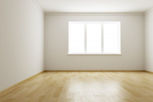 an empty room with wooden floors