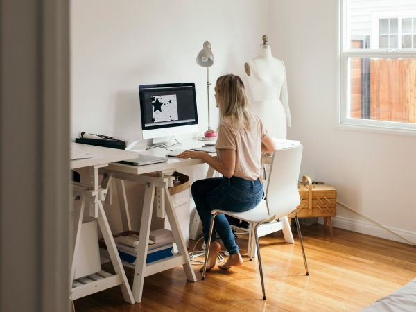 a woman working from home in her home office