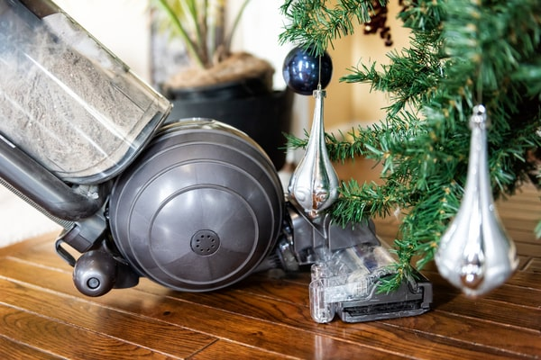 A vacuum cleaner under the christmas tree