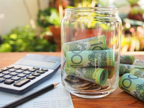 Australian money in a glass jar